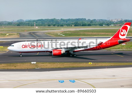 DUSSELDORF, GERMANY - MAY 21: Airbus A330 lands on May, 21 2011 in Dusseldorf airport, Dusseldorf, Germany.The AirBerlin is the second largest airline in Germany.