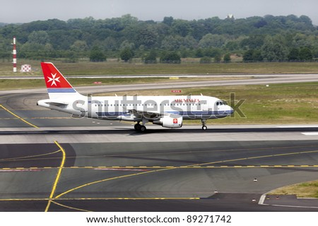 DUSSELDORF, GERMANY - MAY 21: Airplane Airbus A319-111 landed in the airport on May, 21 2011 in Dusseldorf. In 2011 Air Malta wet-leased one A320 (9H-AEN) to Sky Airline.