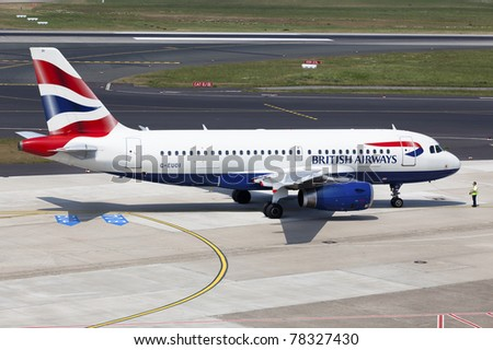 DUSSELDORF, GERMANY - MAY 21: Airplane Airbus A319 prepared for takeoff on May, 21 2011 in Dusseldorf, Germany. British Airways and Iberia completed their merger and created the world's third-largest airline. - stock photo