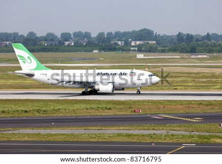 DUSSELDORF, GERMANY - MAY 21: An A310 lands on May, 21 2011 in the airport, Dusseldorf, Germany. Mahan Air as the largest carrier in Iran country increased flights from its hub in Tehran to Dusseldorf.