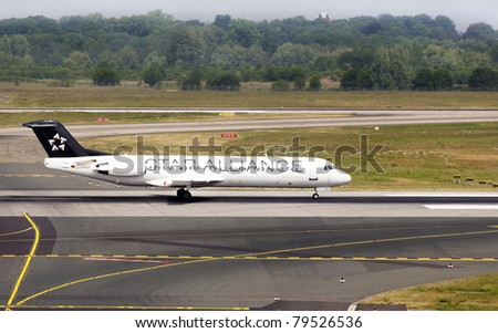 DUSSELDORF, GERMANY - MAY 21: Fokker 100 of ContactAir airlines landed n the Dusseldorf airport on May, 21 2011. Star Alliance is the world's first and largest airline alliance.