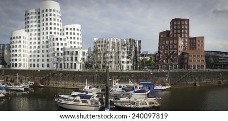 DUSSELDORF, GERMANY - MAY 13: Media Harbor in Dusseldorf, Germany. Spectacular post-modern architecture in the Hafen district by Frank Gehry on MAY 13, 2014. - stock photo
