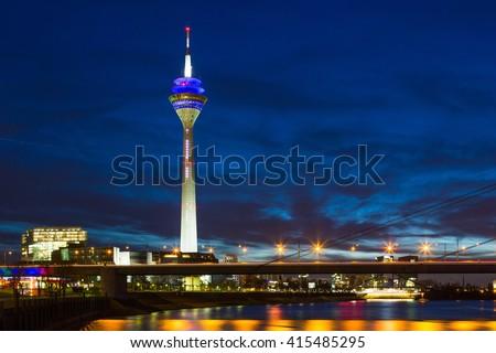 Dusseldorf - Germany. night scene includes media tower and bridge on Rhine river - stock photo