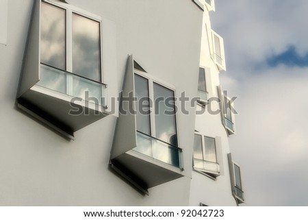 DUSSELDORF, GERMANY - NOVEMBER 18: View of the Neuer Zollhof in Media Harbor in Dusseldorf, Germany at November 18, 2011. This building complex was designed by Frank O. Gehry and completed in 1998.