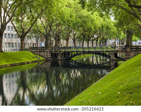 Dusseldorf, Germany, on July 6, 2014. Kyonigsalley - one of the central city streets - stock photo