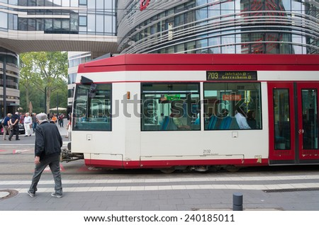 DUSSELDORF, GERMANY - SEPTEMBER 6, 2014: Passing rheinbahn tram. The Rheinbahn is operating in and around Dusseldorf. Its network consists of 7 light rail lines, 13 tram and 92 bus services - stock photo