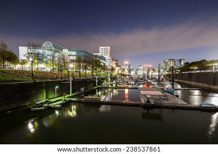 Dusseldorf media harbor and Neuer Zollhof at night - stock photo