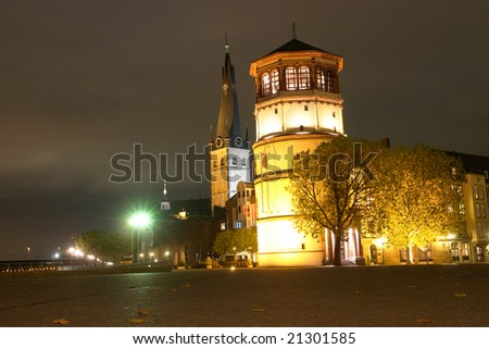 Dusseldorf - Schlob?turm and Lambertuskirche, Burgplatz - Navigation museum - stock photo