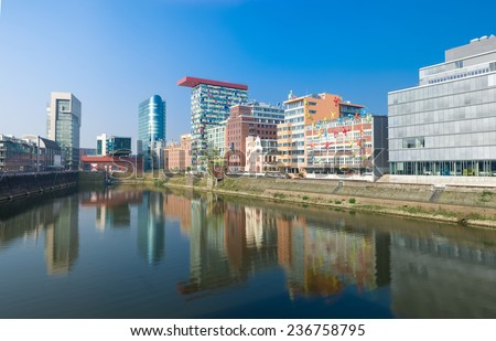 DUSSELDORF - SEPTEMBER 6, 2014: Modern office buildings in the media harbour. The Hafen district contains some spectacular post-modern architecture, but also some bars, restaurants and pubs. - stock photo