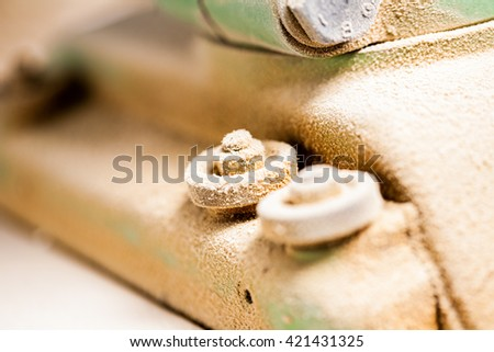 dust covered woodworker machinery bolt detail - stock photo
