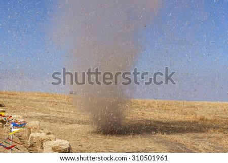 Dust devil kicking up debris in a dry field near Davenport, WA. - stock photo