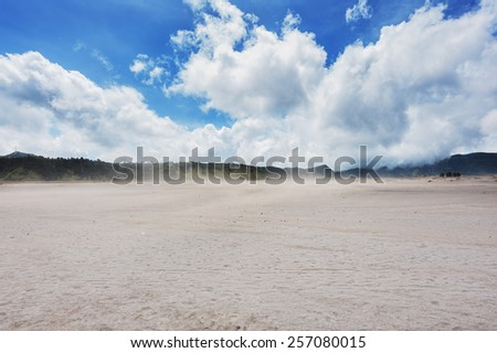 dust from the wind on the mountain - stock photo