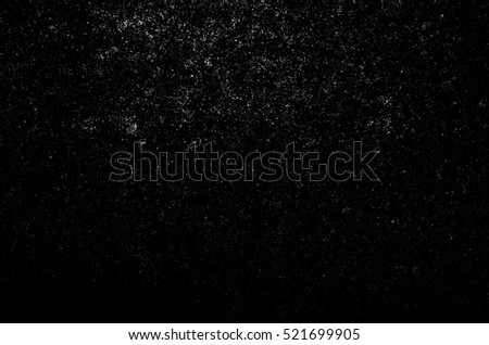 Dust particle white on black background, Dust grain texture, dirt overlay, Grunge background.