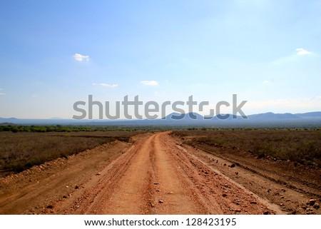 Dust Road to the Kenyan Savannah and Safari - stock photo