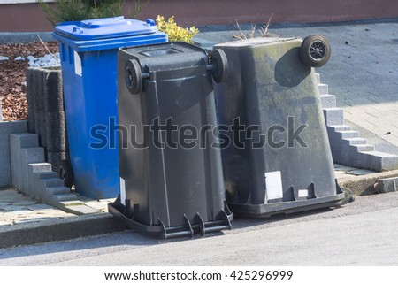 Dustbin with different colored lids for waste separation are upside down. - stock photo