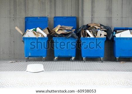 Dustbins full of discarded cardboard boxes - stock photo