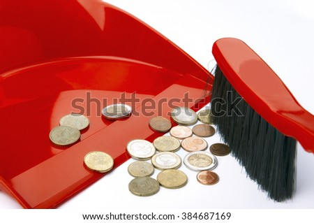 Dustpan, brush and eurocent