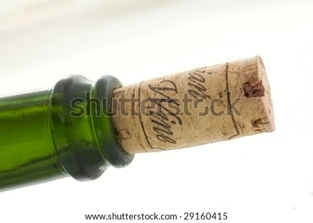 dusty bottle with cork and sign wine on it - stock photo