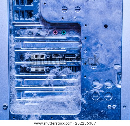 Dusty old computer, rear panel connectors and dust. In blue tones - stock photo