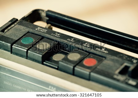 Dusty old radio with one cassette player - stock photo