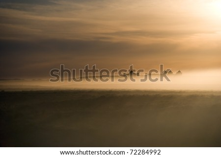 Dusty storm in desert. Ancient east mausoleums. - stock photo