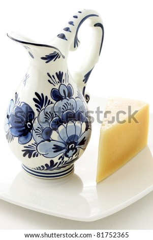 dutch antique glazed blue and white delftware jar, full of fresh milk with gouda cheese
