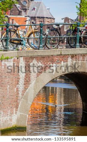 Dutch bike parked on a bridge in Amsterdam, Netherlands - stock photo