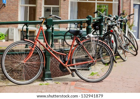 Dutch bike parked on a street in Amsterdam, Netherlands - stock photo