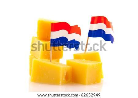Dutch cheese cubes with flag as snack isolated over white - stock photo