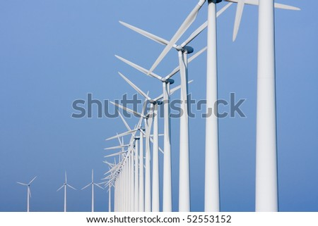 Dutch colonnade of windmills, facing the sky - stock photo