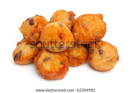 Dutch donut also known as oliebollen, traditional New Year's eve food isolated on white background