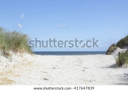 Dutch dunes and sea at the Wadden island Ameland   - stock photo