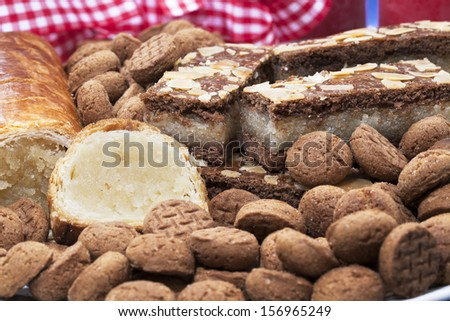 Dutch holiday treats: speculaas, kruidnootjes, almond loaf. - stock photo