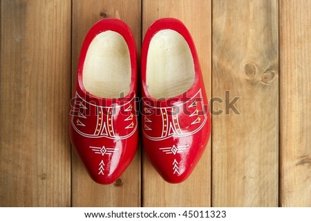 Dutch Holland red wooden shoes on wood background - stock photo