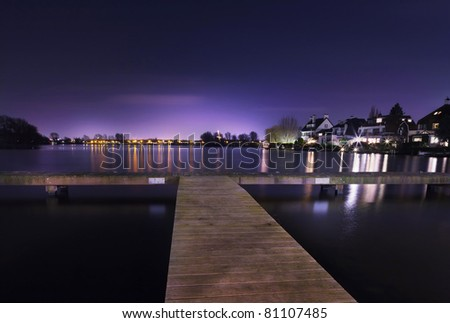 Dutch lake at sunset - stock photo