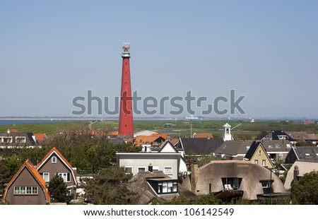 dutch lighthouse with blue sky - stock photo