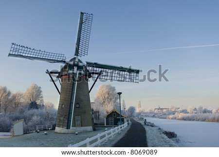 Dutch Mill in winter - stock photo