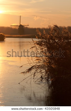 Dutch mill in winter evening light - stock photo