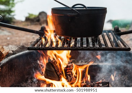 Dutch oven stock images royalty free images vectors for How to cook in a dutch oven over a campfire