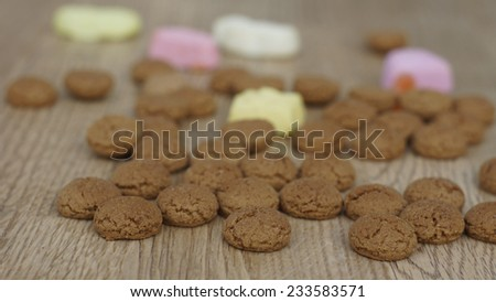 Dutch Pepernoten on the floor, typical Dutch treat for Sinterklaas on 5 december - stock photo