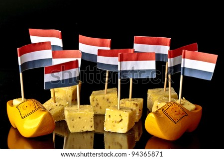 Dutch pickle cheese and clogs with dutch flags - stock photo
