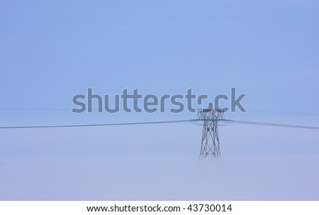 Dutch power line in foggy withe winter weather.