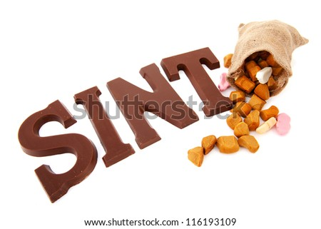 Dutch Sinterklaas candy with presents and pepernoten - stock photo
