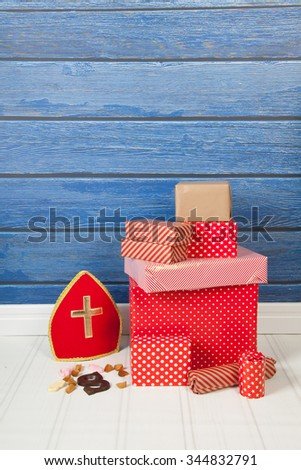 Dutch Sinterklaas gifts and candy on blue background - stock photo