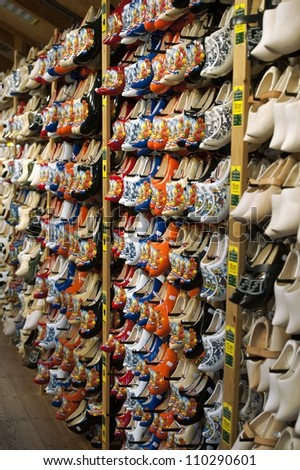 Dutch souvenir shop with handmade wooden clogs - stock photo