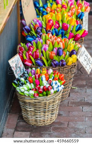 Dutch souvenirs - wooden tulips for sale on an Amsterdam market - stock photo