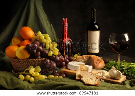 Dutch still-life with wine, bread and fruit