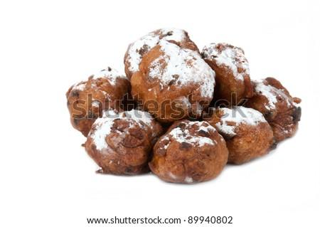dutch traditional oliebollen with powder sugar on white - stock photo