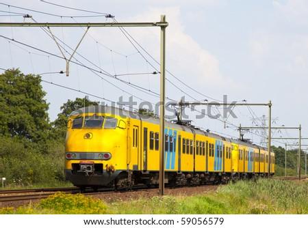 dutch train is a typical dutch landscape - stock photo