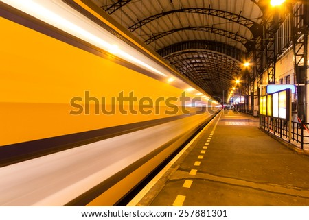 Dutch train pulling away out of train station - stock photo